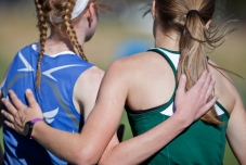 1st and 2nd place winners Karlee Simmons, right, of Hill City and Haleigh Timmer of St. Thomas embrace each other at the end of the 2016 Region 5A Cross Country Meet at Rocky Knolls Golf Course in Custer.