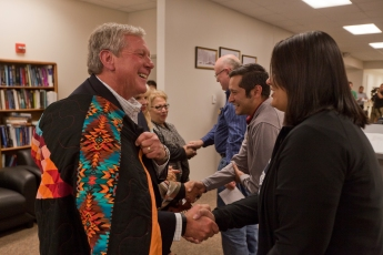 "School donor Bob Malone of Texas greets a line of students, faculty and supporters of the Tiospaye Center for American Indian Scholars at the South Dakota School of Mines & Technology, which was expanded after a generous donation by the family of Maria ""Agnes"" Roybal Trujillo."