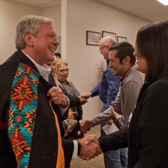 """School donor Bob Malone of Texas greets a line of students, faculty and supporters of the Tiospaye Center for American Indian Scholars at the South Dakota School of Mines & Technology, which was expanded after a generous donation by the family of Maria """"Agnes"""" Roybal Trujillo."""
