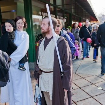 From right, David, Laura and Mathew Scott wait in line with others to get into Storyteller Bookshop during Scare in the Square in downtown Rapid City on Saturday afternoon. The couple and their son were representing all three Star Wars trilogies.