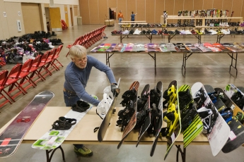 lines up snow boards in preparation for the Black Hills Ski for Light Ski Swap which will take place Saturday at Rushmore Civic Center. The swap is a fund raiser for the annual event that gives a day of skiing to impaired children and adults.