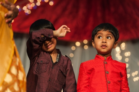 Shaan Sakaria, left, and Shriram Gangineni look on as the kids fashion show progresses during Diwali Night at the School of Mines on Saturday evening.