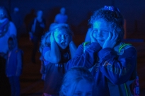 """Kylie Robinson, forefront, covers her ears as police cars wail their sirens during the third, """"Operation Citation"""" at the Dunbar United Methodist Church in Dunbar, W.Va., on Tuesday, November 28, 2017. Created by the Charleston Police Department Traffic Division, '""""Operation Citation"""" honored four Girl Scouts this evening."""