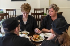 Brianna, Ruth Kelly, Isaac and Kachina have a moment together before sampling the day's specials at the Fruits Of Labor Cafe in Rainelle, W.V., on Friday, April 13, 2018.