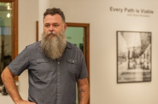 Curator Roger May is seen in the apartment earth art gallery in Charleston, W.V. on Wednesday, August 08, 2018.