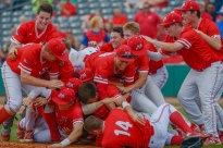 Hurricane High School Redskins celebrate their victory over Wheeling Park High School in the Class AAA state baseball championship at Power Park in Charleston, W.V., on Saturday, June 02, 2018