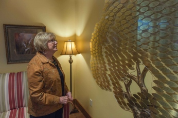 Mary Kathren Robinson, longtime Administrator for the Hubbard Hospice House in Charleston, W.V., pauses in front of the memory tree, which is filled with the names of those who have passed on in the care of the hospice house.