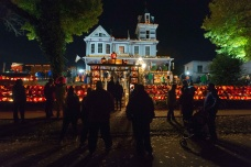 Visitors line the street and yard of the famous Kenova Pumpkin House in Kenova, W.V., on Halloween night, October 31, 2017.