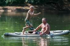 CRAIG HUDSON | Gazette-Mail Eli Hamilton, 7, jumps into the Elk River as his grandfather don watches on Thursday, July 20, 2017.