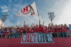 Hurricane fans crowd the stands during the Hurricane Redskins-Winfield Generals football game at Hurricane High School on Friday, August 25, 2017.