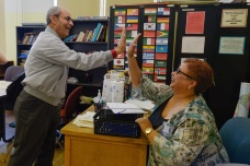 Malyka Knapp-Smith gives a hi-five to Asmael Saifo of Syria during her English as a Second Language class at the Garnet Career Center in Charleston on Monday, August 28, 2017.