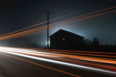 Truck lights frame a house in this long exposure taken in the town of Daily along the Seneca Trail.