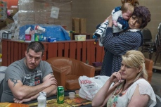 From left, Joel Mckinney, his mother Linda Mckinney and his wife Melissa Clark speak with a reporter inside Five Loaves & Two Fishes Food Bank in Kimball, W.V., on Tuesday, March 27, 2018.