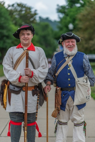 West Virginia Sons of the American Revolution Association members Zach Mason, left, and Bob Grumbling, respectively dressed as a soldier of the 7th Virginia Militia and as a soldier of the Westmoreland County Pennsylvania Militia, pose for a portrait on West Virginia day outside of the Culture Center in Charleston, W.V., on Wednesday, June 20, 2018.