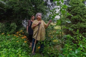 Herbalist apprentice Kara Vaneck follows herbalist master Maron Harless around Maron's garden outside of Elkins, W.V., on Monday, July 30, 2018.
