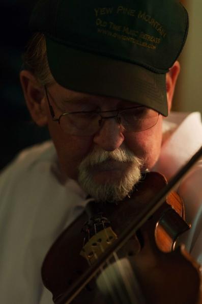 Fiddler apprentice Jen Iskow and fiddler master John Morris play a song together inside John's home in Ivydale, W.V., on Monday, July 30, 2018.